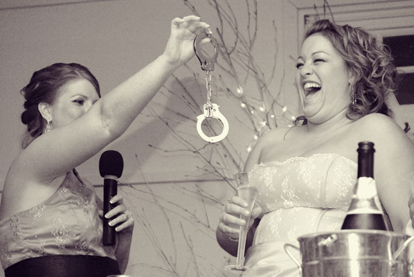 Bride and Bridesmaid with handcuffs