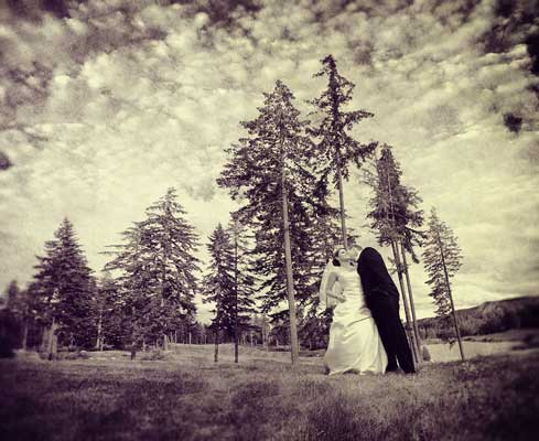 Bride and Groom under the bright sky